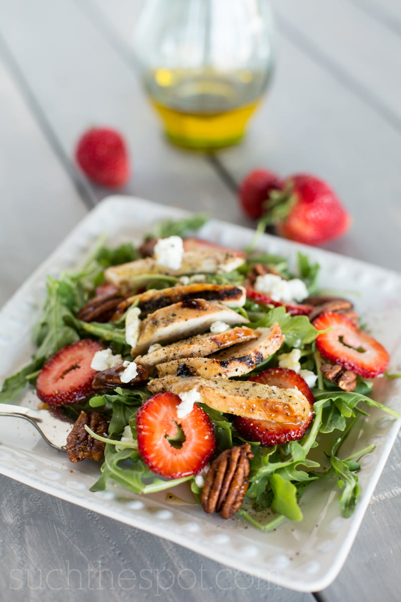 Arugula salad with grilled chicken, summer berries & candied pecans