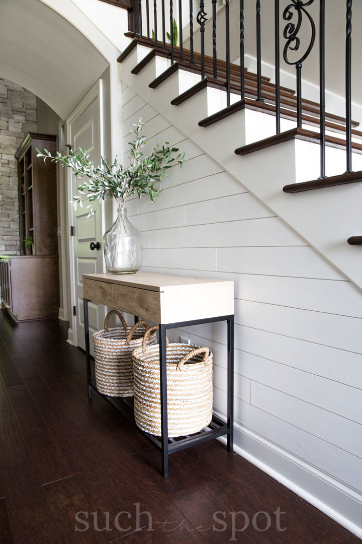 Entryway vignette in a home staged for real estate sale
