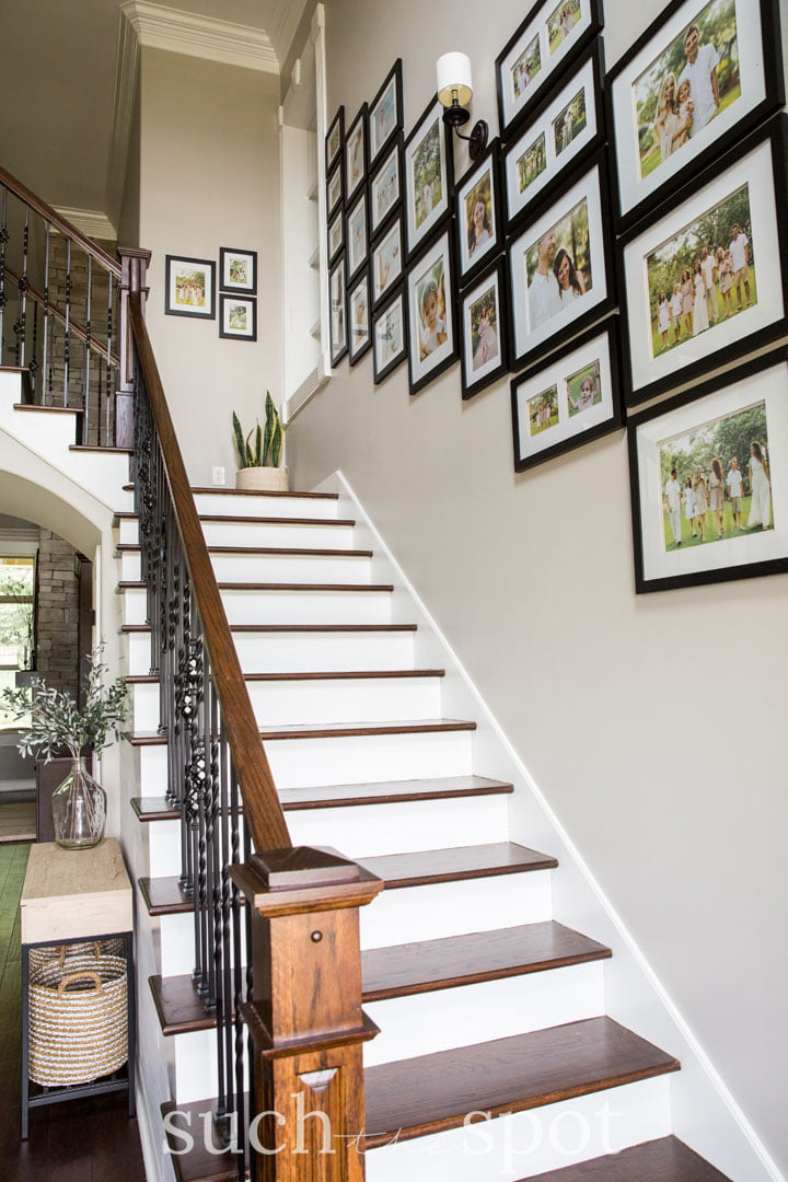 Staircase gallery wall in a home staged for real estate sale