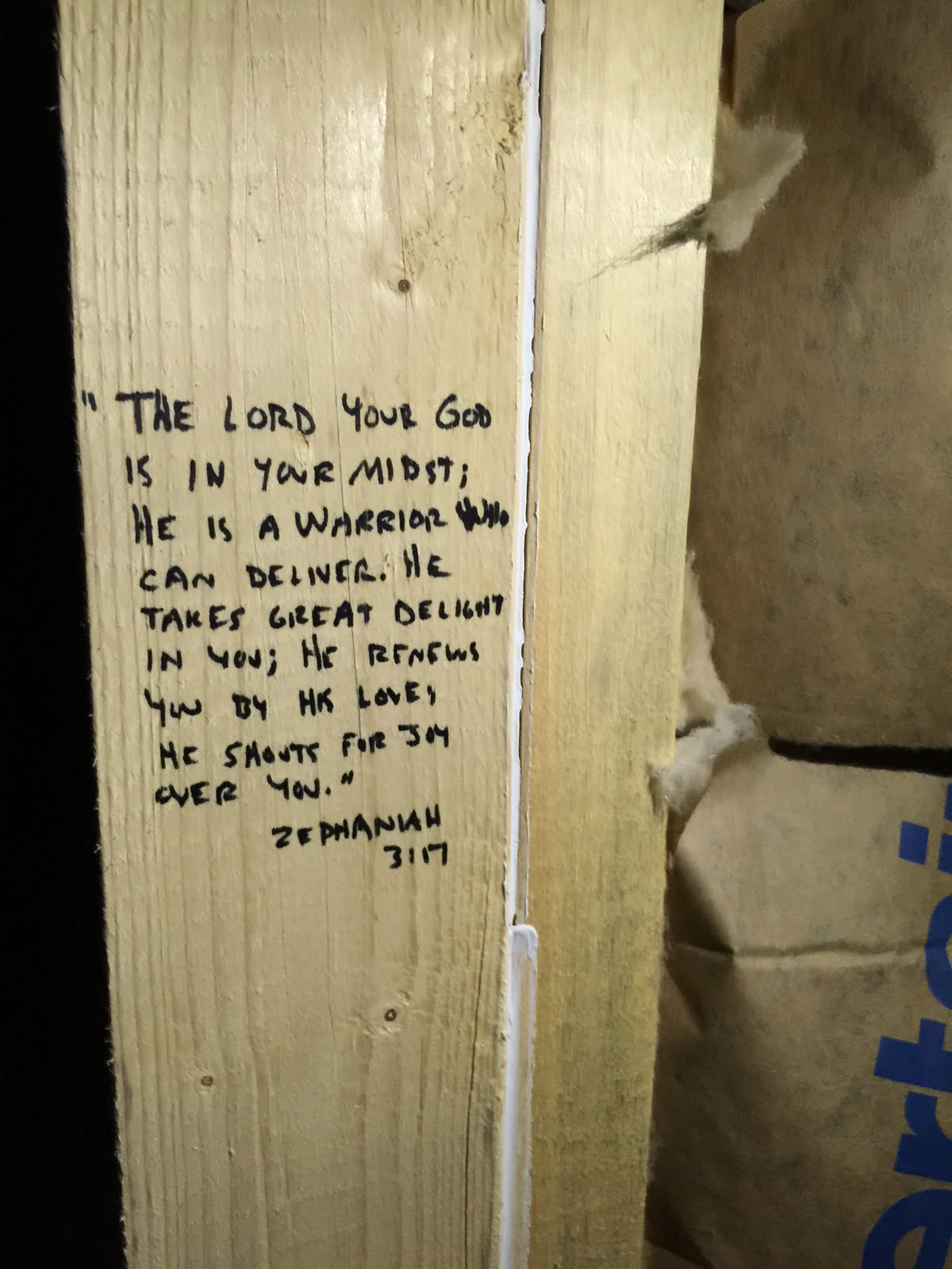 Scripture on support beams of new construction house
