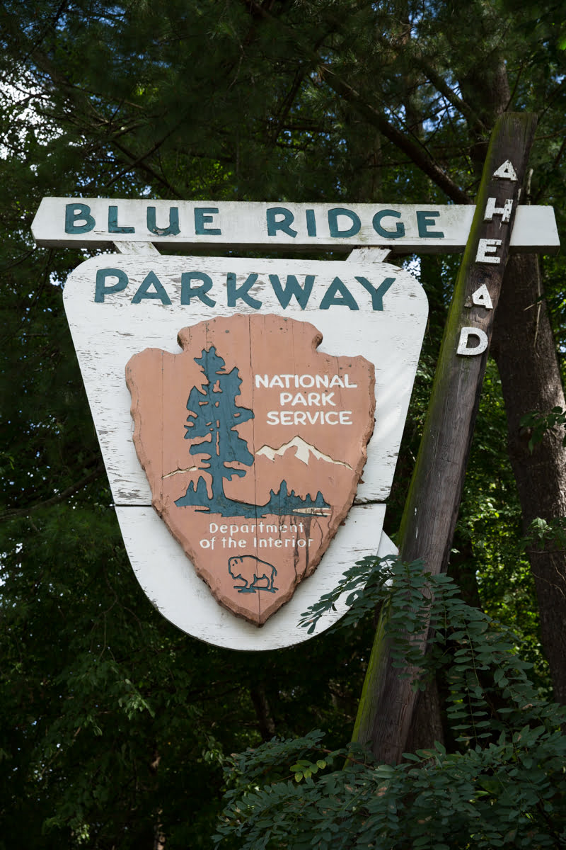 """The Blue Ridge Parkway, called """"America's Favorite Drive,"""" is a U.S. National Parkway that winds 469 miles through Virginia and North Carolina, connecting Shenandoah National Park on its northern end and the Great Smoky Mountains National Park on its southern end."""