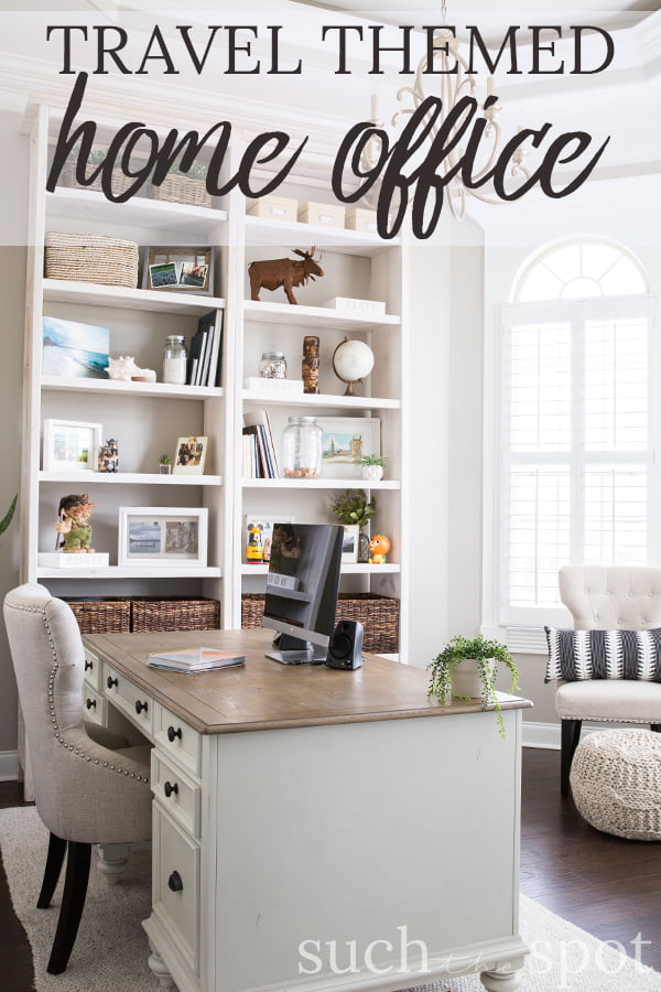 white executive desk with white office chair and white eleven foot shelves