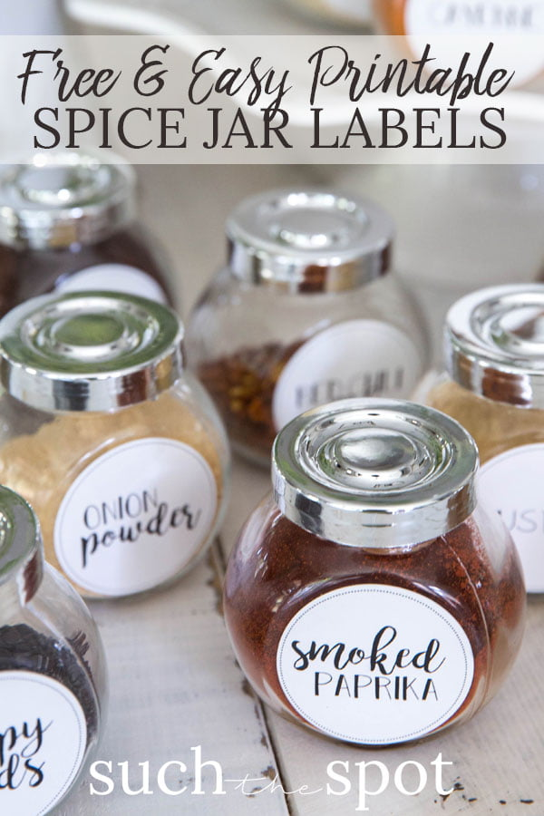 Several small Ikea jars with free printable spice jar labels