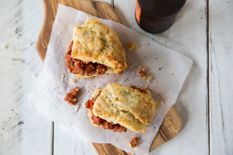 You've not tried a sloppy joe until you taste these Turkey Sloppy Joes on Apple Cheddar Biscuits. This recipe elevates this family favorite meal into something worthy of serving at a dinner party. Or your next tailgate, whichever.