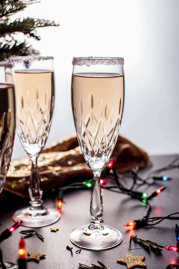 These 12 fun and festive Christmas cocktails take a grown-up spin on favorite holiday flavors. Check this list (twice) for something to serve for a crowd at your Christmas party!