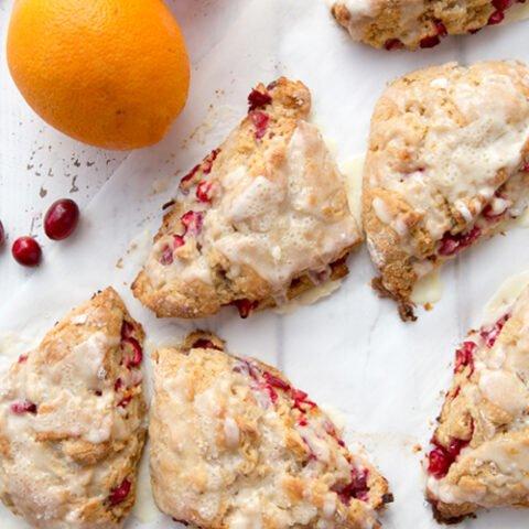 Cranberry orange scones on a piece of parchment paper