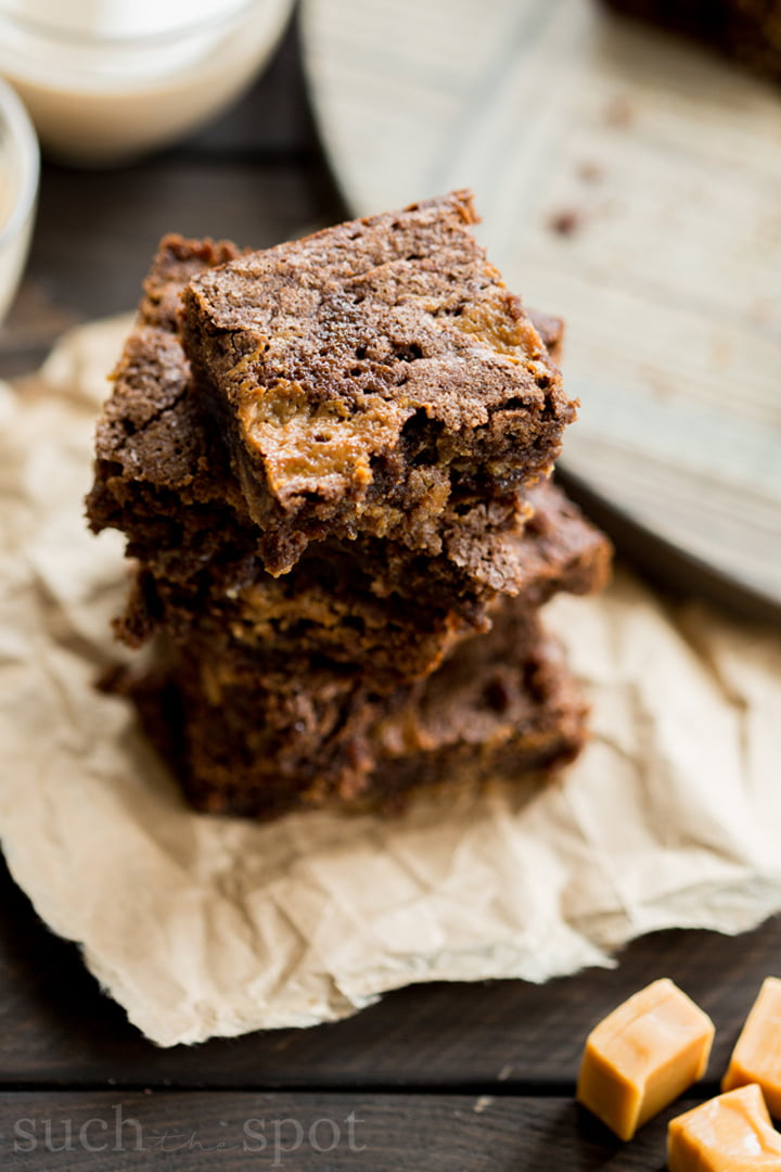Stack of four ooey, gooey Bailey's Irish Cream Caramel brownies