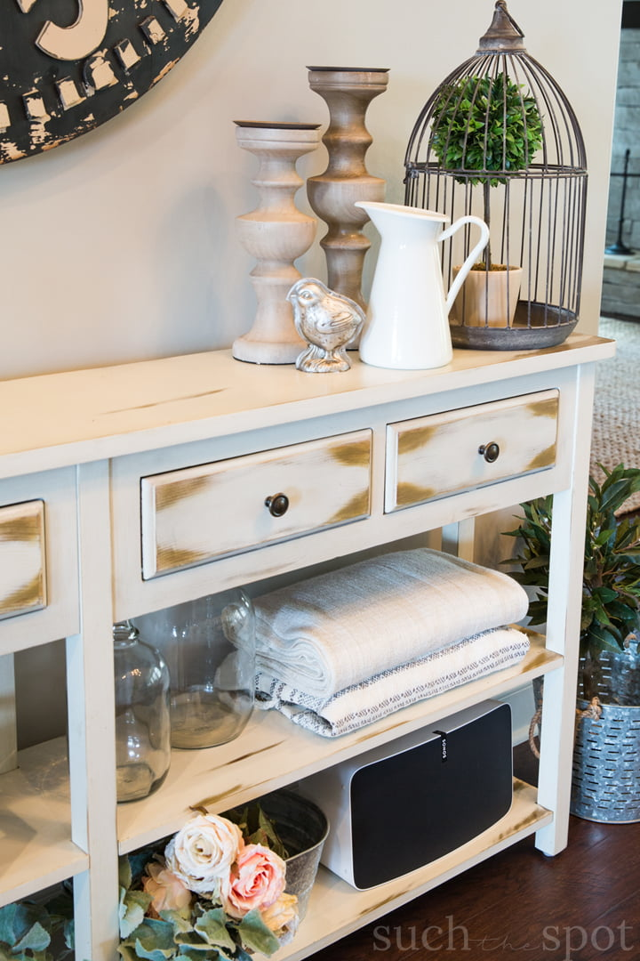 A modern farmhouse console table with spring decor