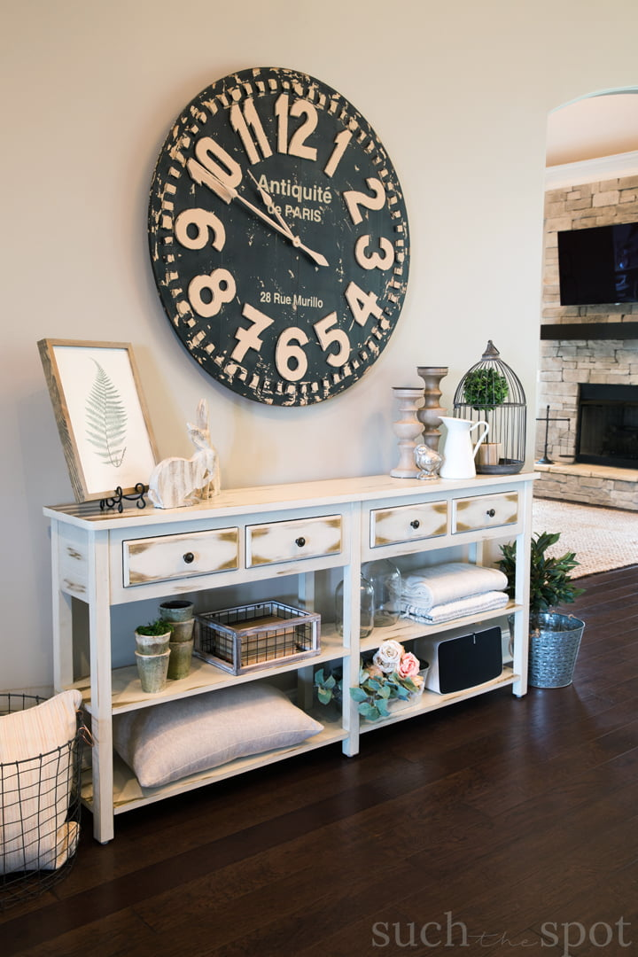 A modern farmhouse console table with spring decor