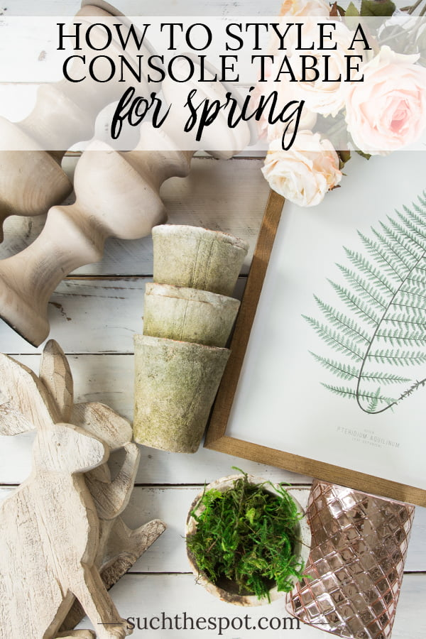 rustic candlesticks, wooden bunnies, ceramic pots for use in a modern farmhouse console table spring decor