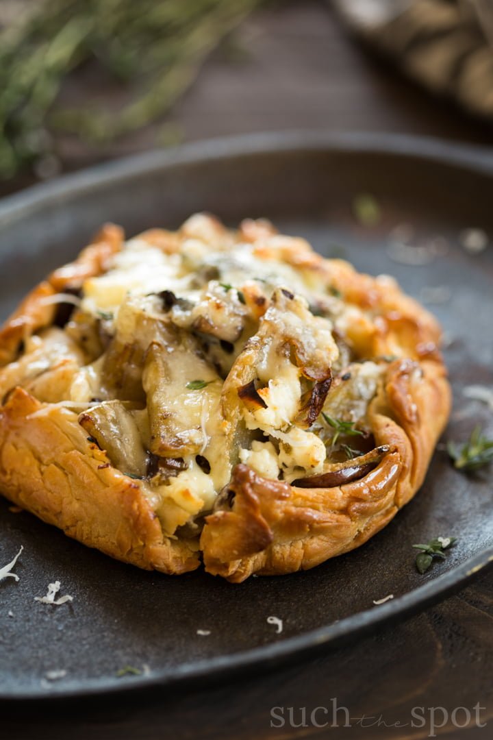 Potato, leek, goat cheese and thyme breakfast pie on a plate.