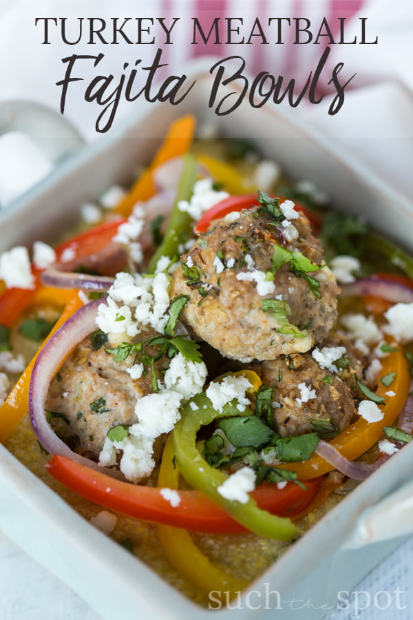 Turkey Meatball Fajita Bowls include turkey meatballs, sliced bell peppers and red onion on a bed of creamy polenta.