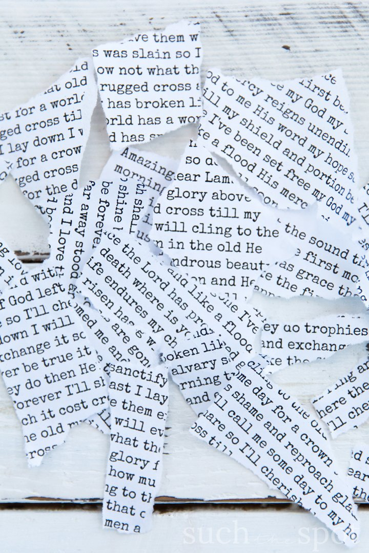 Strips of torn paper with words in typewriter font