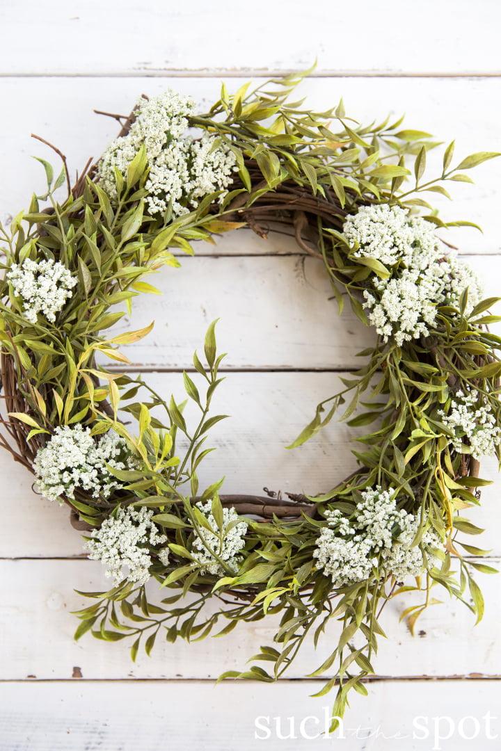 Wild greenery wreath with white flowers