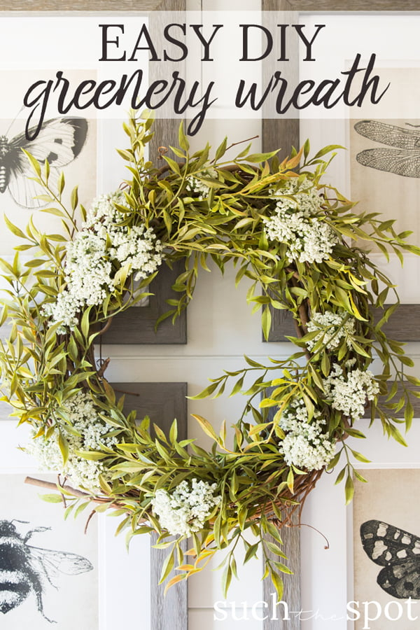 Wild greenery wreath with white flowers