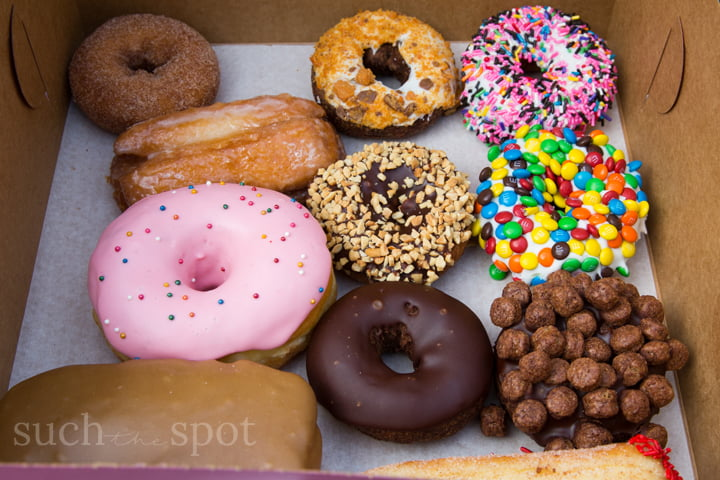 assorted raised and cake doughnuts from Voodoo Doughnut in Portland, Oregon