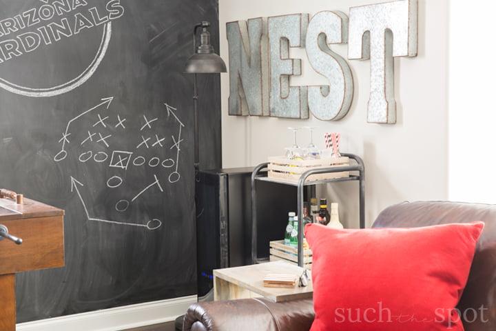 Football man cave chalkboard wall with Arizona Cardinals logo