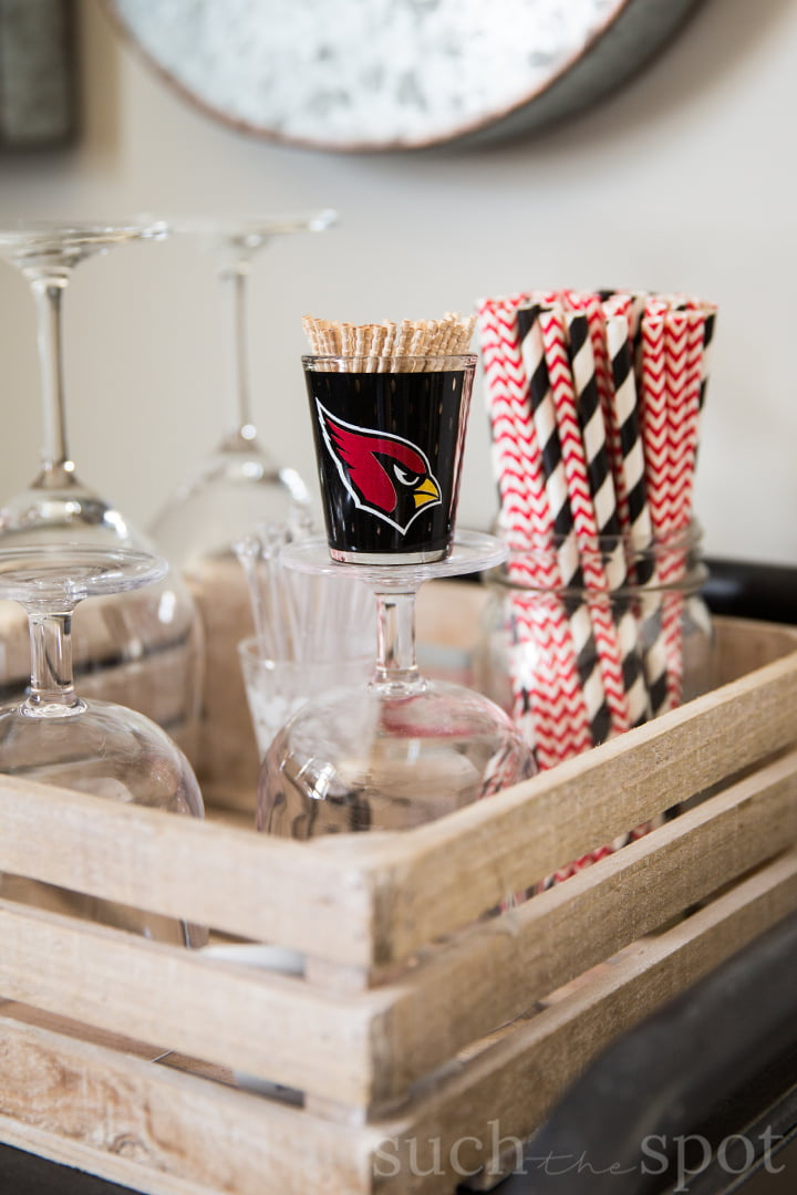 Arizona Cardinals shot glass with red and black paper straws