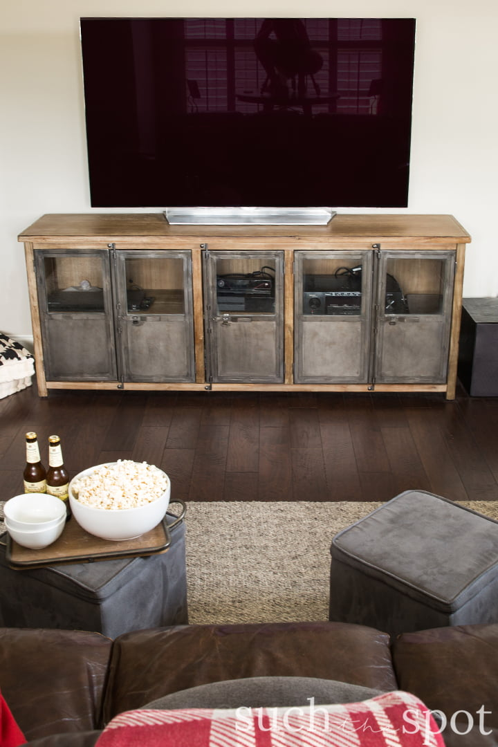 Gray washed wood and metal media cabinet