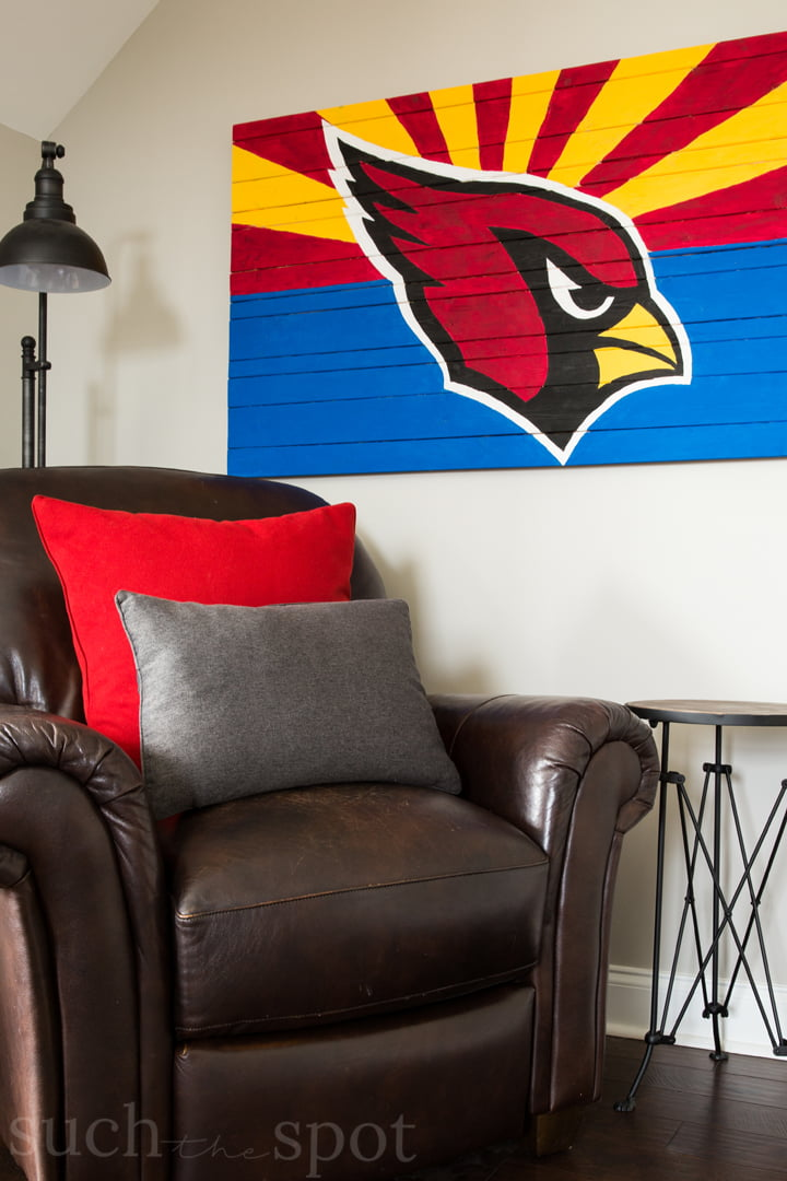 Arizona Cardinals logo against an Arizona state flag painted on wood