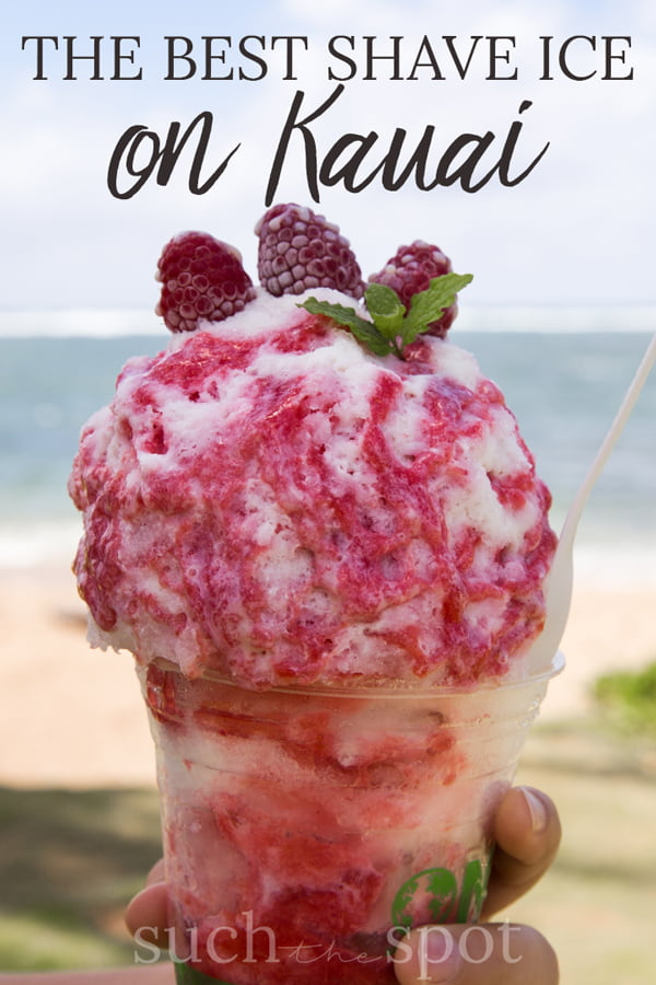 Hawaiian shave ice topped with raspberry syrup and frozen raspberries.