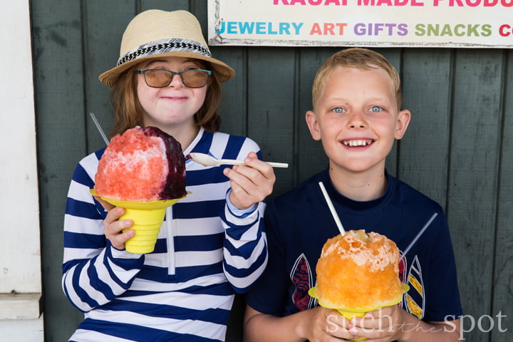 two children with shave ice as big as their heads