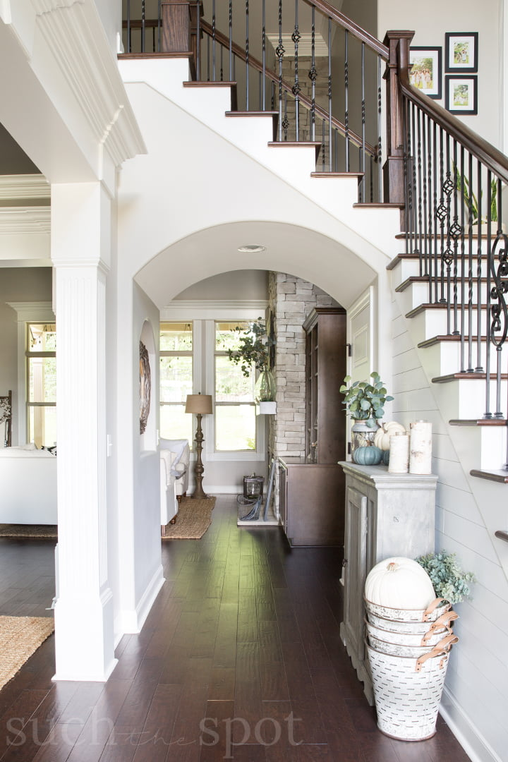 Entryway of two story home with shiplap and visible staircase