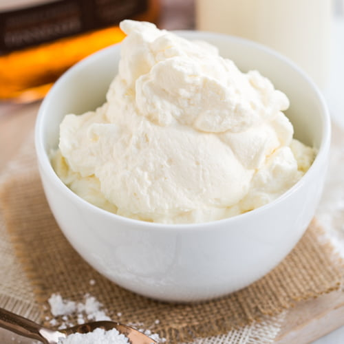 bowl of homemade bourbon whipped cream placed on a square of burlap