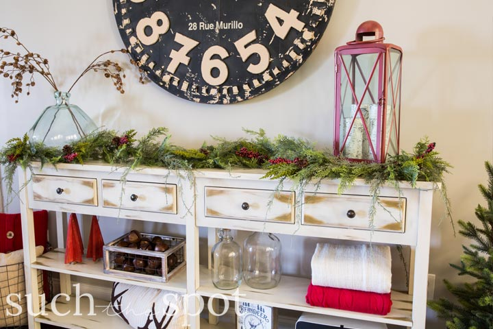 favorite christmas decor styled on a console table