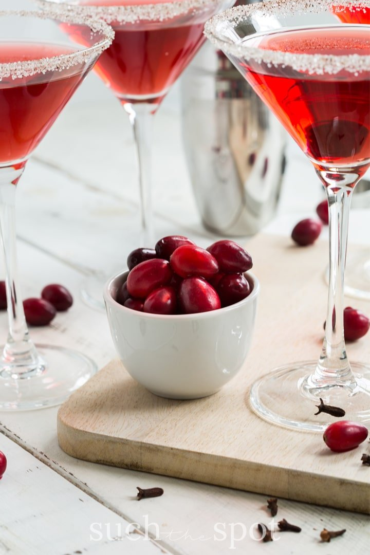 easy five-minute cranberry pear martinis in martini glasses with sugared rim