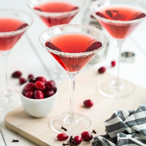 easy five-minute cranberry pear martinis in martini glasses with sugared rim