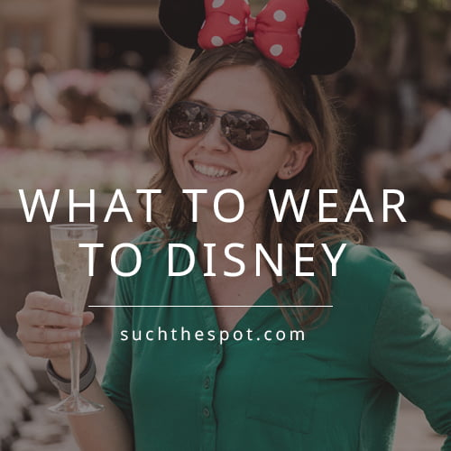 girl wearing cute outfit and mickey ears holding champagne at Epcot