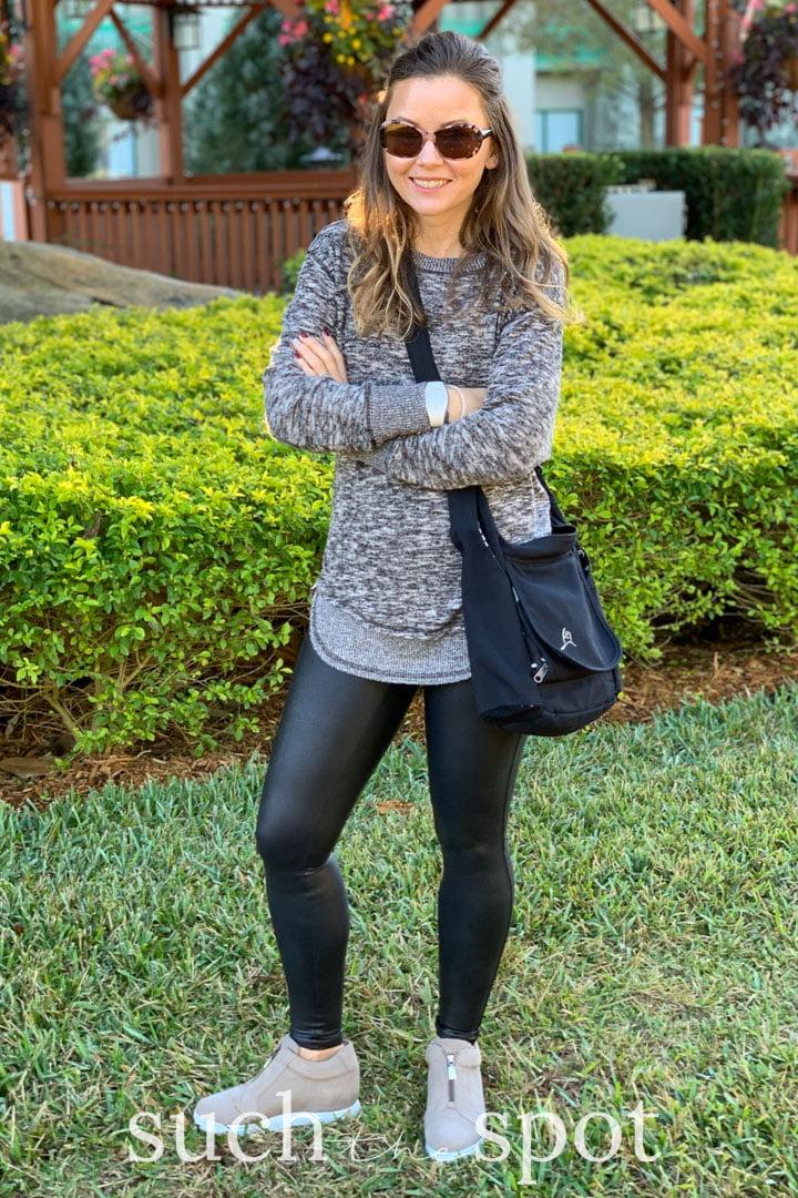 Girl wearing spanx faux leather leggings for Disney World