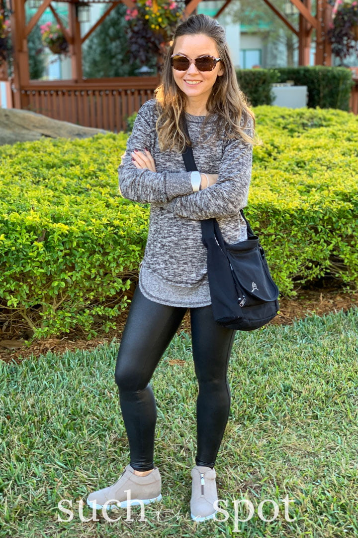 Girl wearing spanx faux leather leggings for Disney World