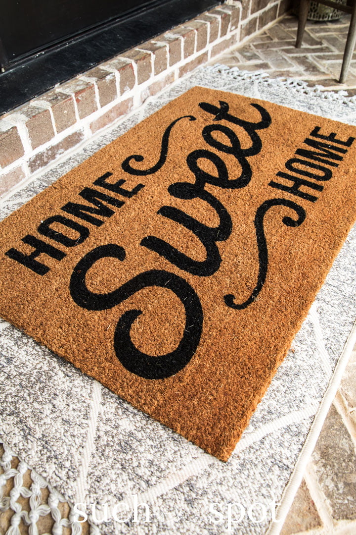 summer front porch layered rugs