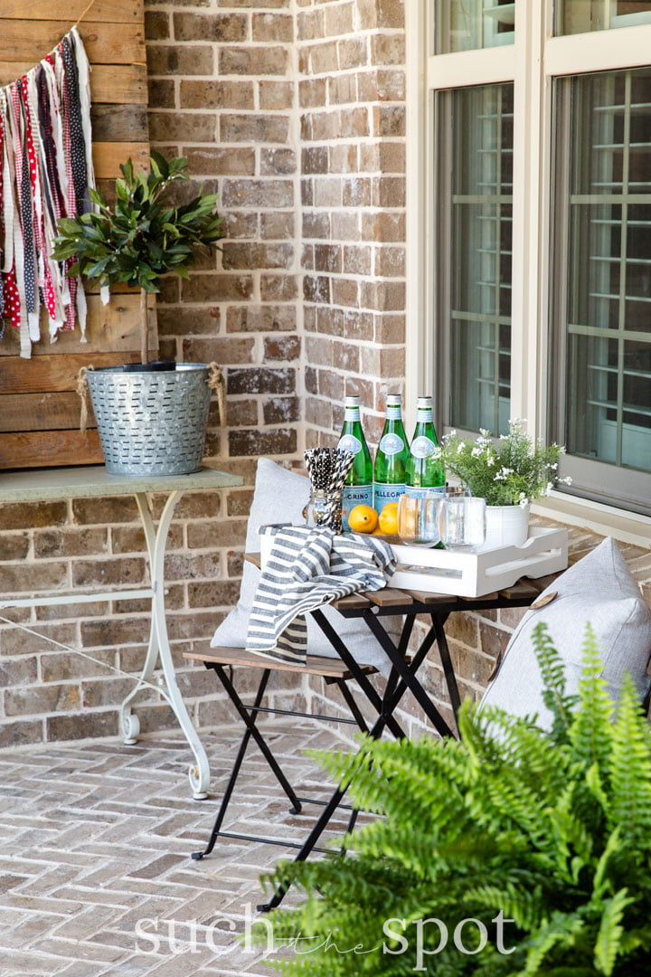 summer front porch vignette with bistro table