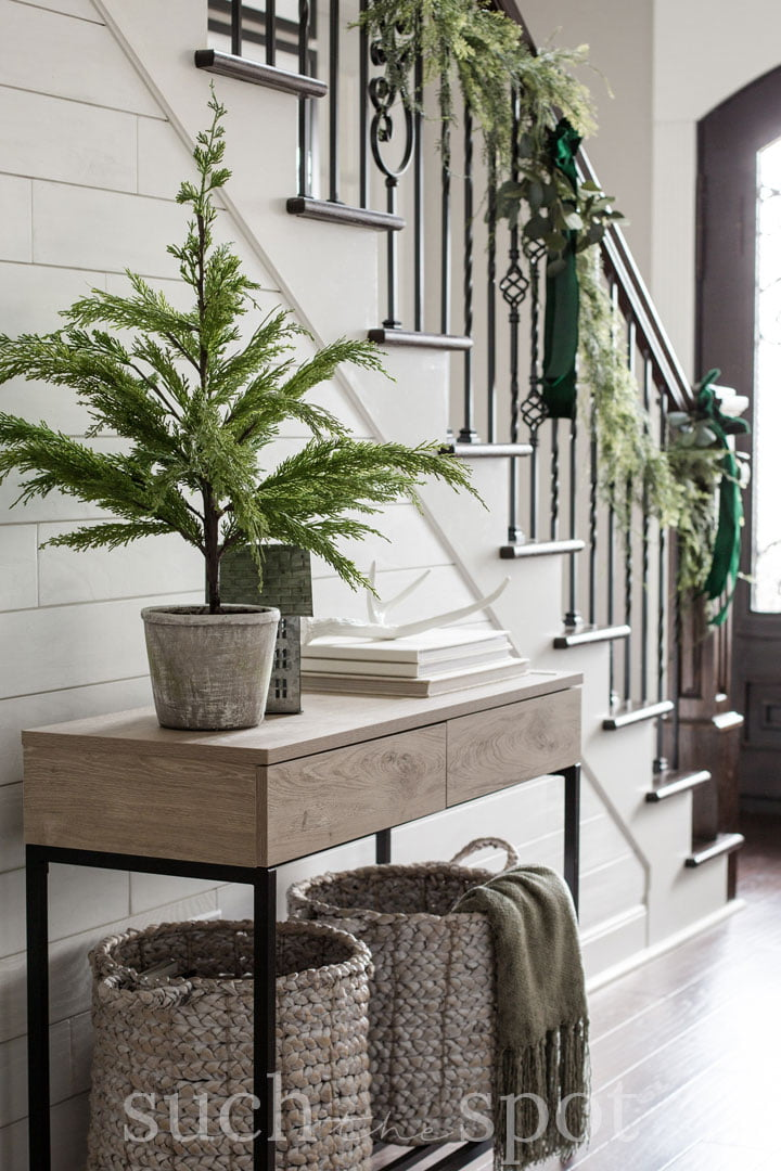Entryway with staircase garland and green velvet bows