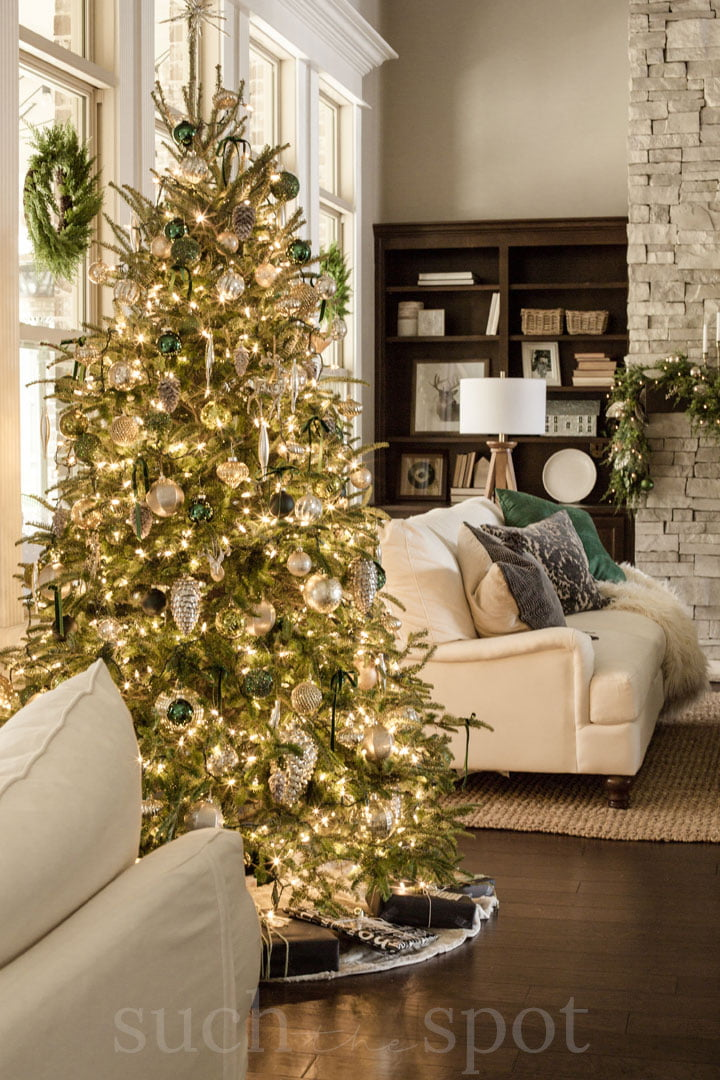 Green and gold ornaments on Christmas tree
