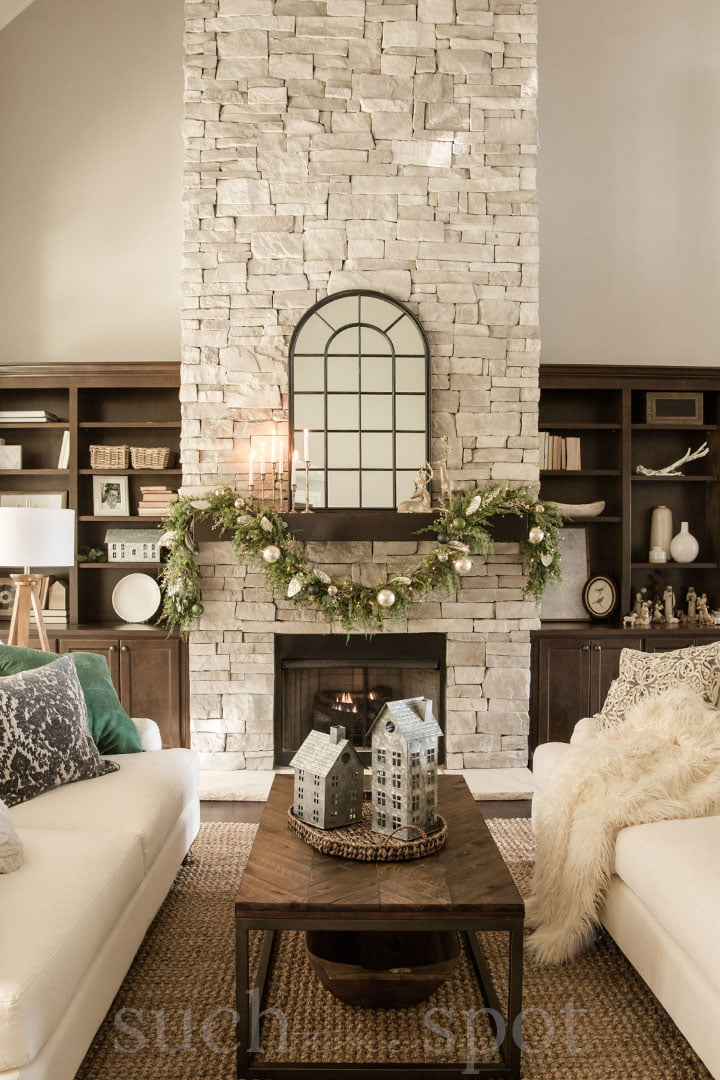 Two story great room with stone fireplace decorated for Christmas