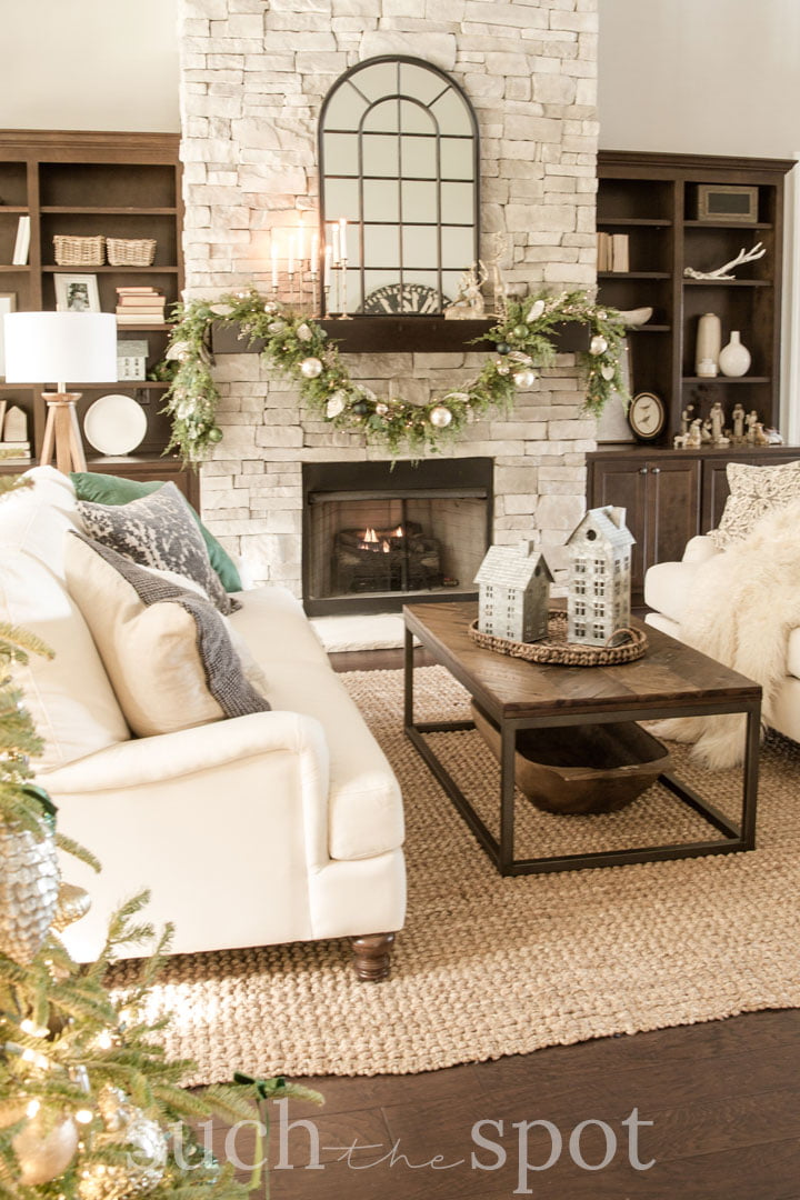 White sofas with green and gold Christmas decor