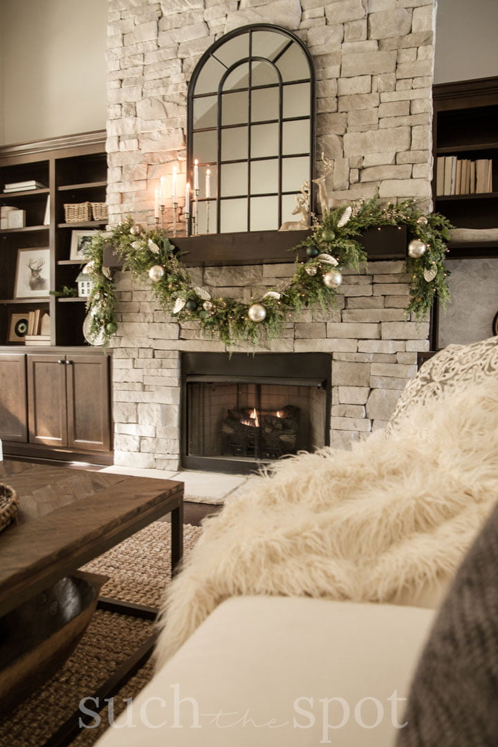Gold and green Christmas decor in living room