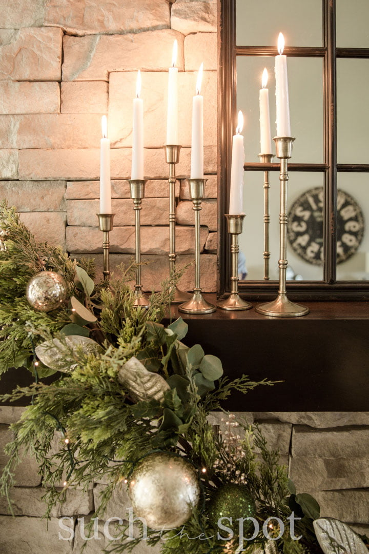 Candlesticks on mantel with beautiful Christmas garland