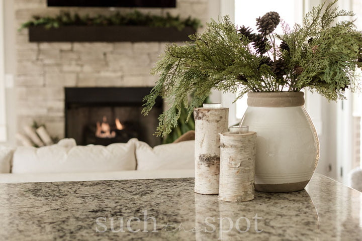 Birch candleholders used for simple and beautiful Christmas decorations in the kitchen